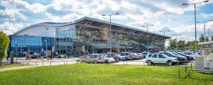 bratislava flygplats panorama 300x120 - Bratislava, Slovakia - October 6 2019: View Of Bratislava Airport Terminal With Parking Lot Full Of